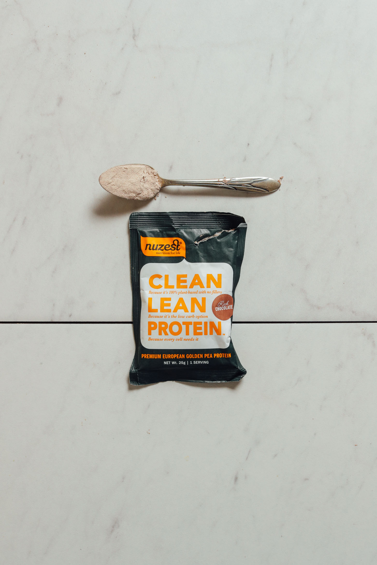 Pouch of Nuzest Chocolate Protein Powder for our vegan protein powder review