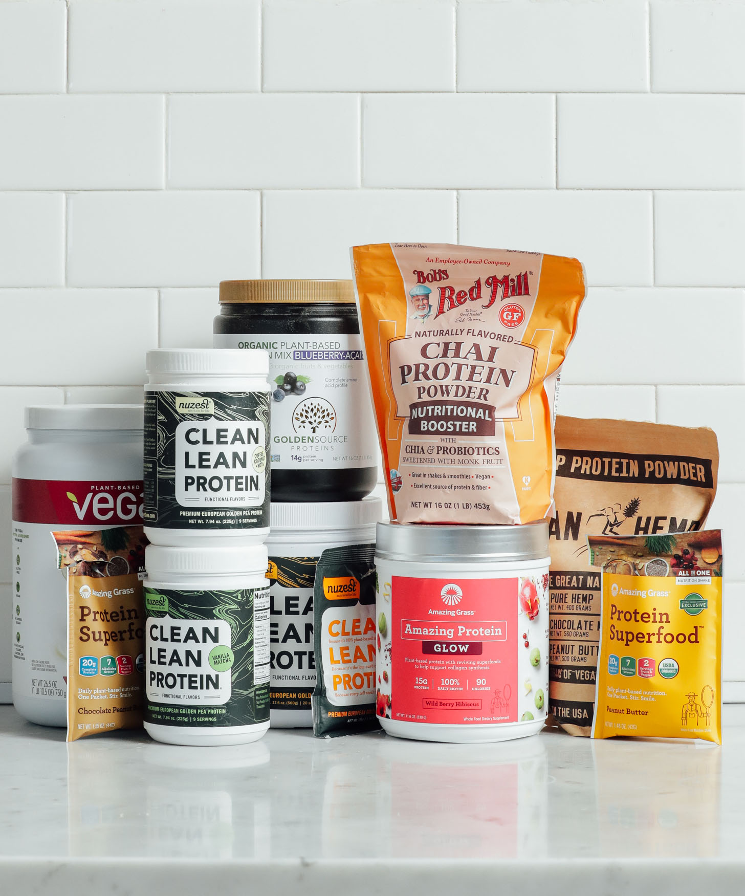Assorted protein powders for our plant-based flavored protein powder review