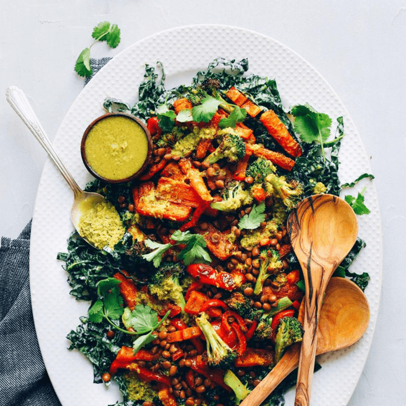 Platter of Curried Lentil Salad with Kale Roasted Veggies and a bowl of Green Curry Dressing