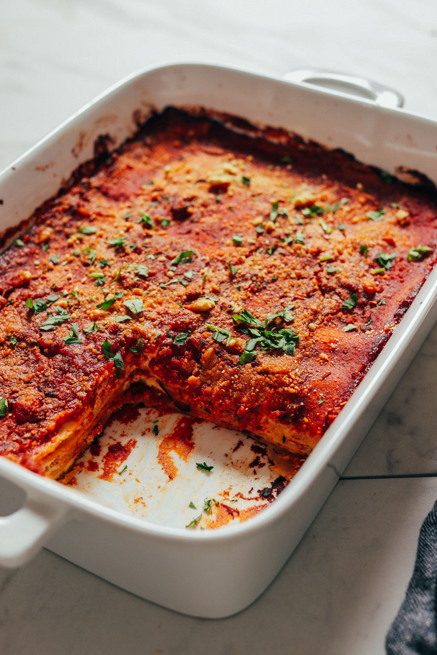 Pan of Easy Vegan Lasagna with a serving removed