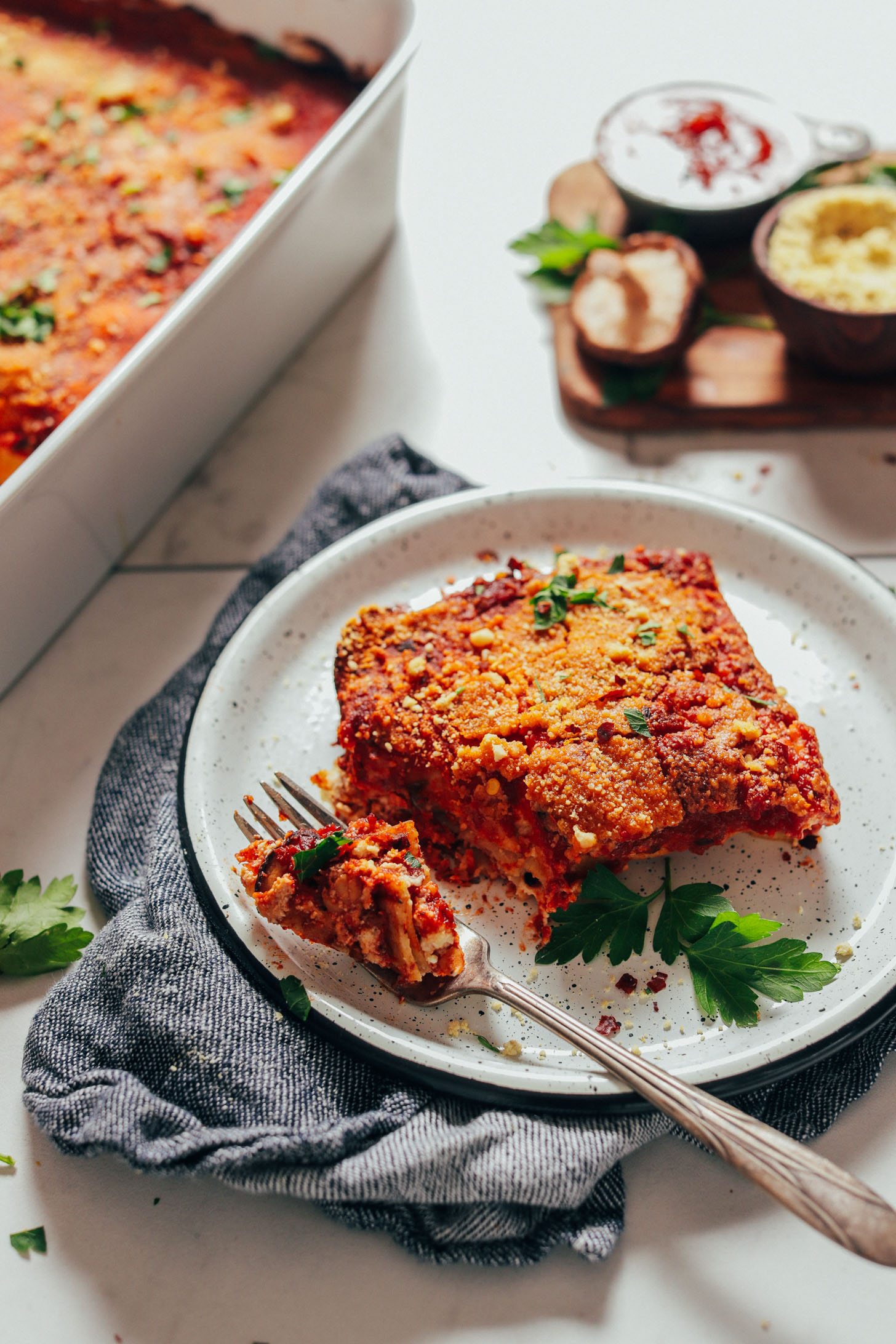 Using a fork to grab a bite of our flavorful Vegan Lasagna recipe