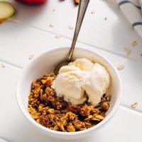 Bowl of Healthified Apple Crisp with vanilla ice cream