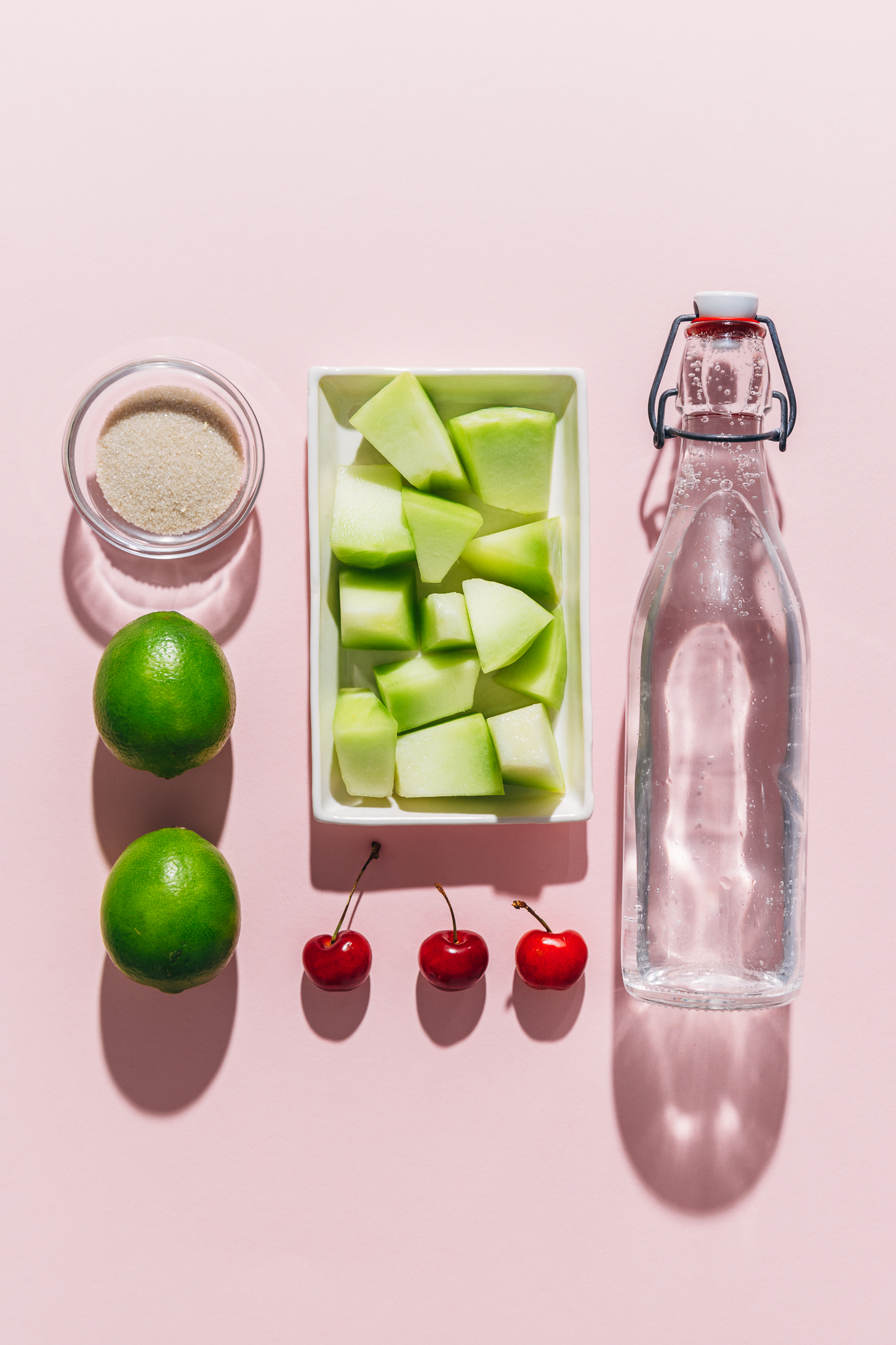 Melon, cherries, lime, and other ingredients for making our virgin Citrus and Melon Spritzer recipe