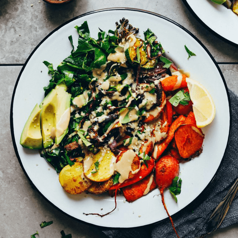 Roasted Rainbow Vegetable Bowl drizzled with tahini sauce