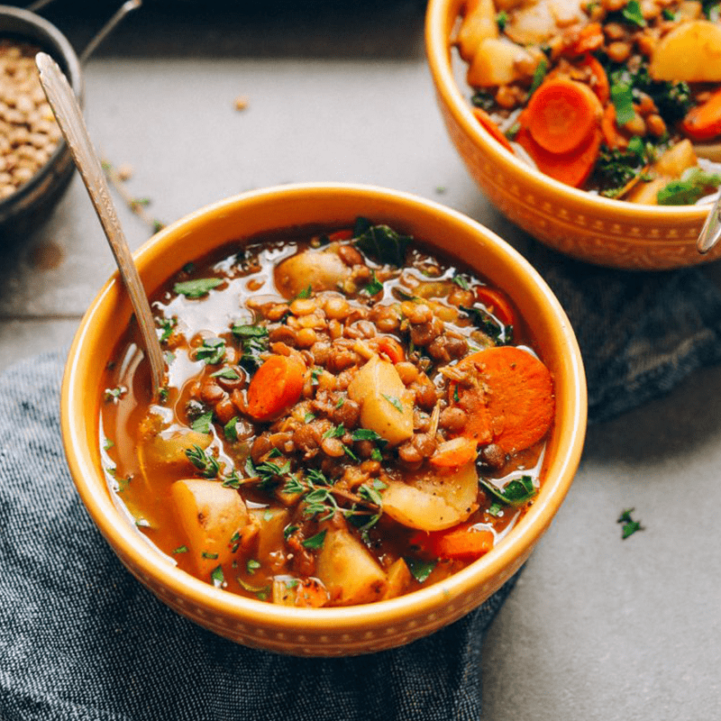 Bowls of Lentil Vegetable Stew for our 12 Comforting Vegan Soups roundup