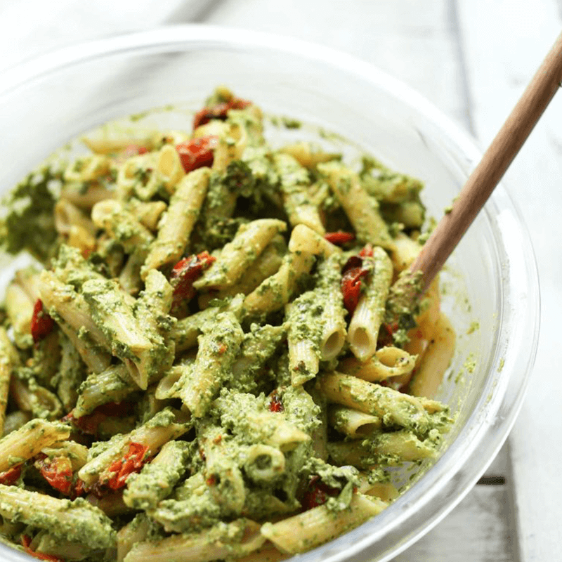 Bowl of Penne Pesto Salad with slow roasted tomatoes