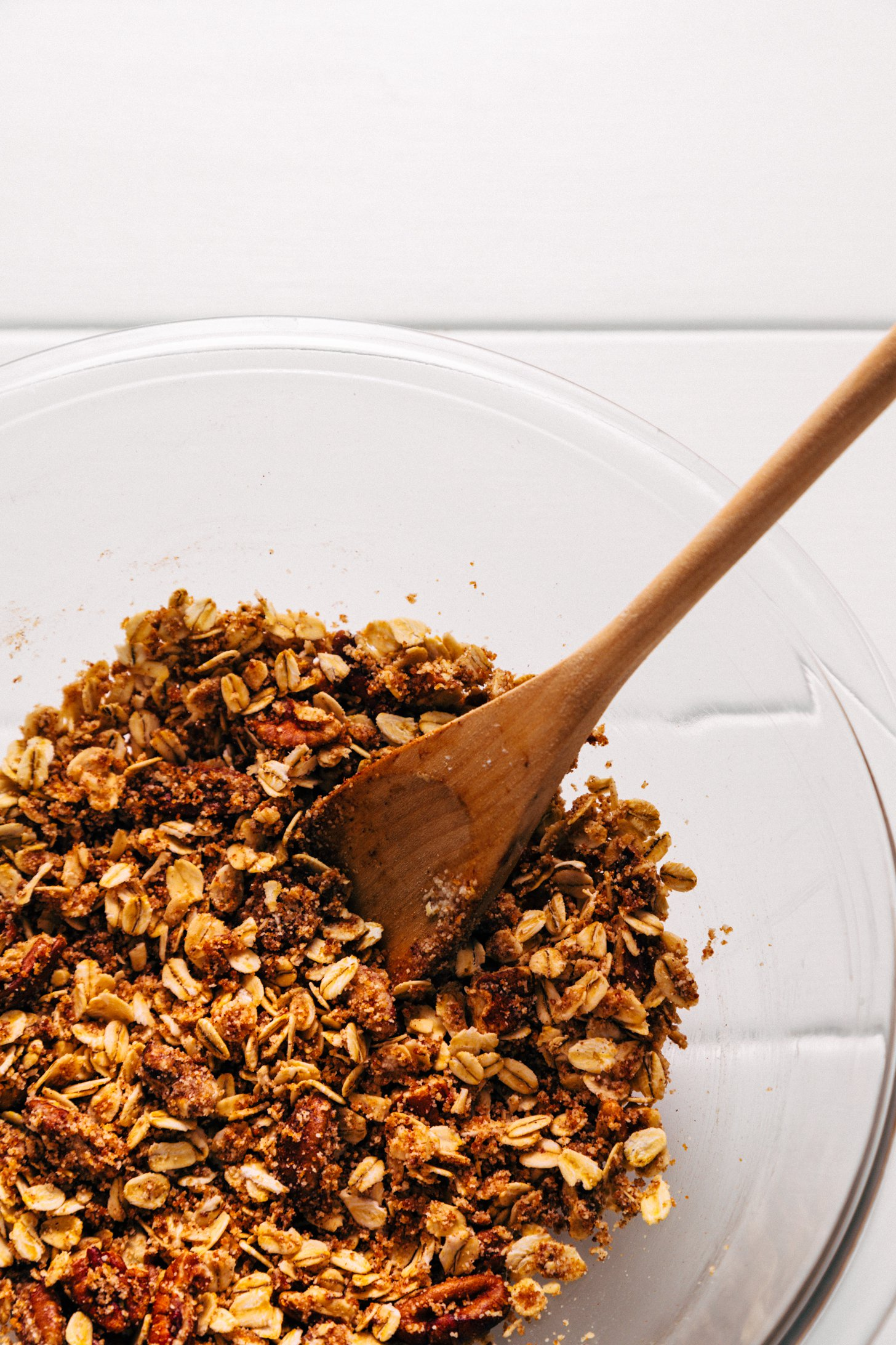 Using a wooden spoon to stir the Pecan-Oat Topping for our Healthified Apple Crisp recipe