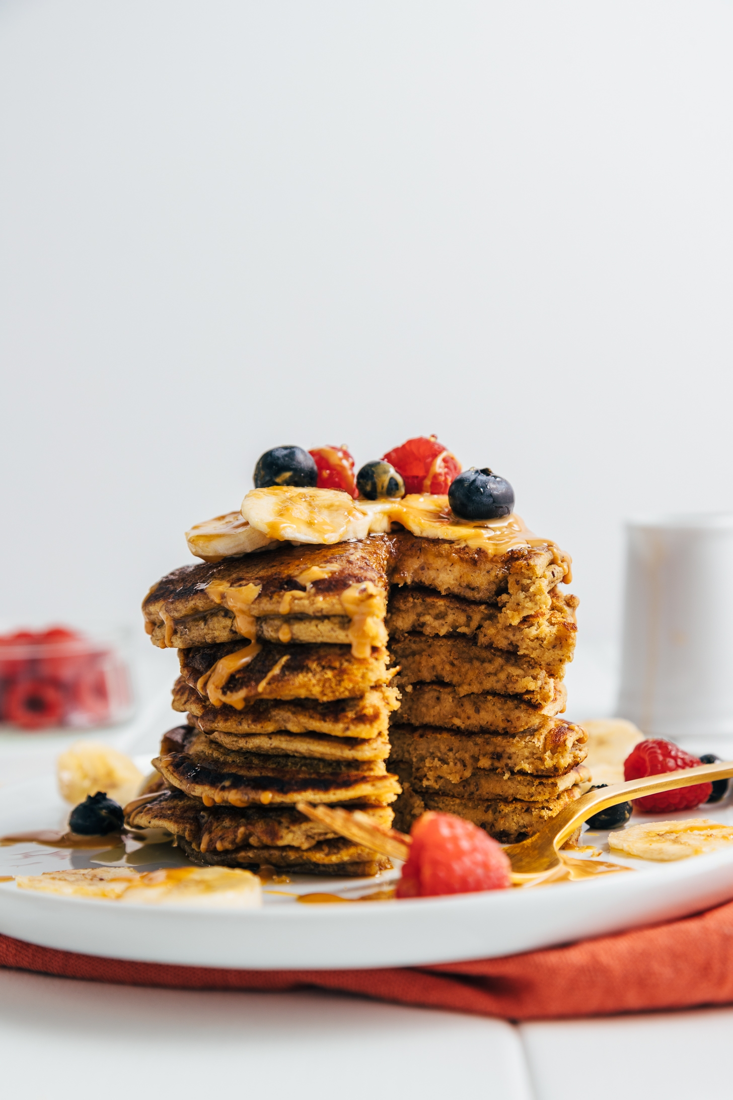 Stack of Peanut Butter Protein Pancakes with a tall slice removed