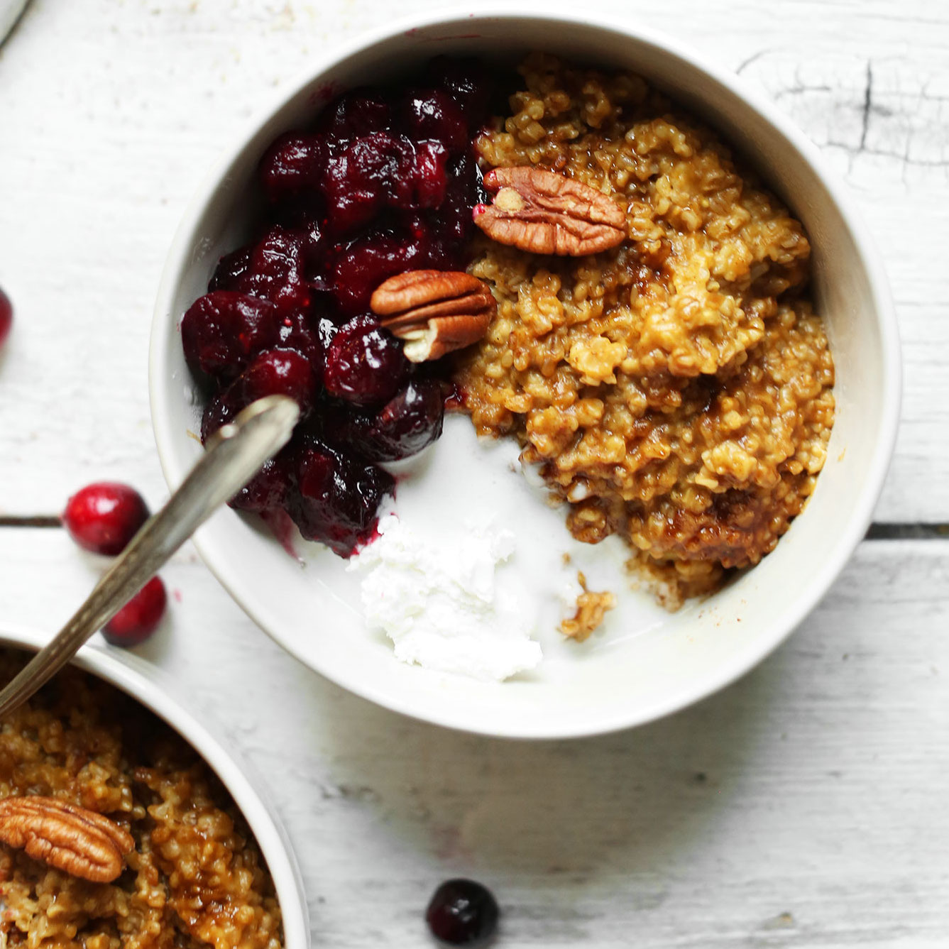 Bowl of Cranberry Pumpkin Oats with Coconut Whipped Cream