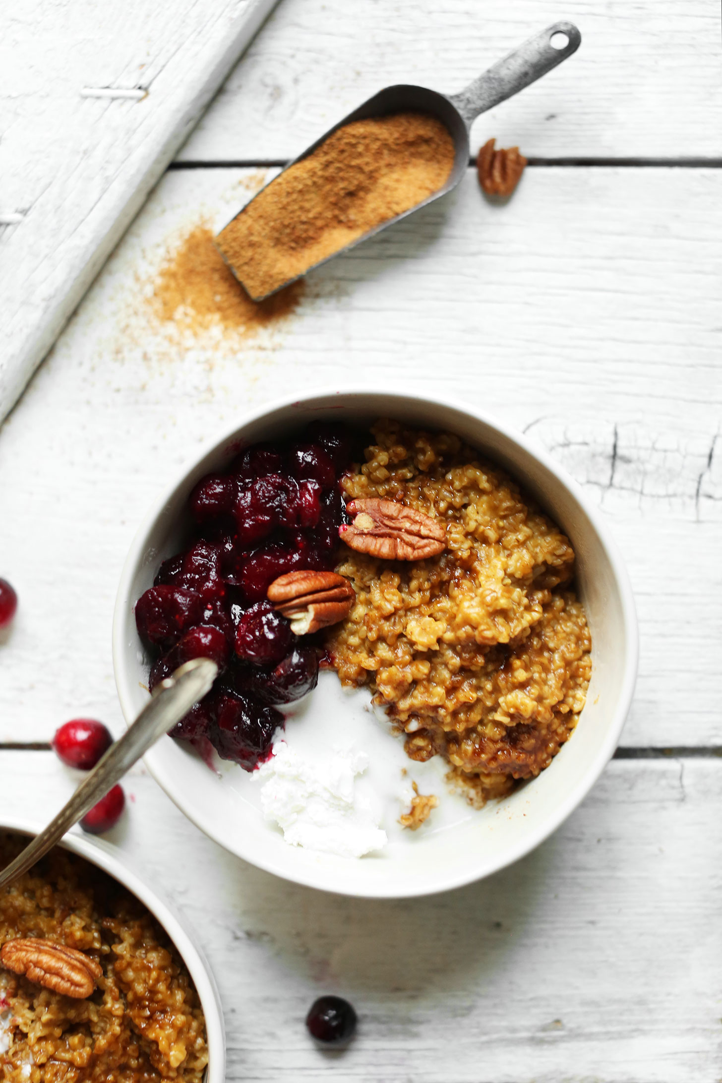 Bowls of Cranberry Pumpkin Steel Cut Oats topped with pecans