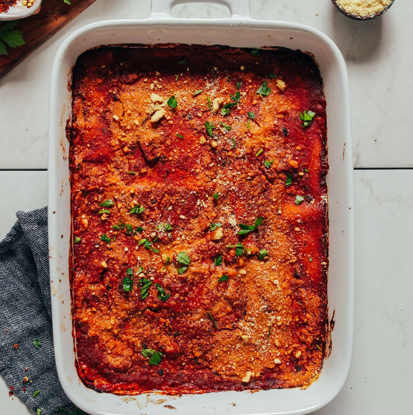 Baking dish of Easy Vegan Lasagna topped with chopped parsley