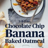 Plate and pan of Banana Chocolate Baked Oatmeal for a delicious make-ahead breakfast