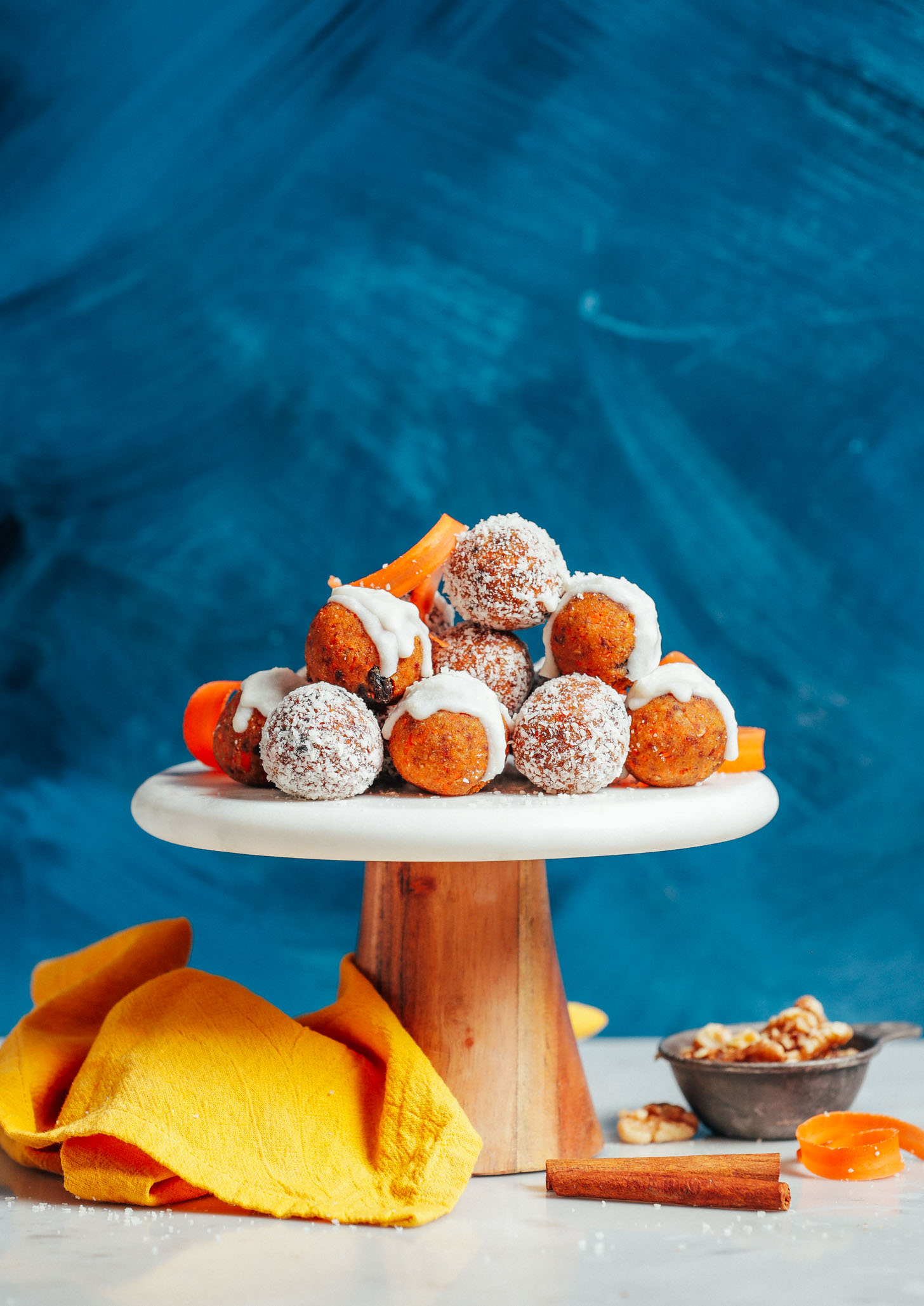 Raw Carrot Cake Bites resting on a cake platter