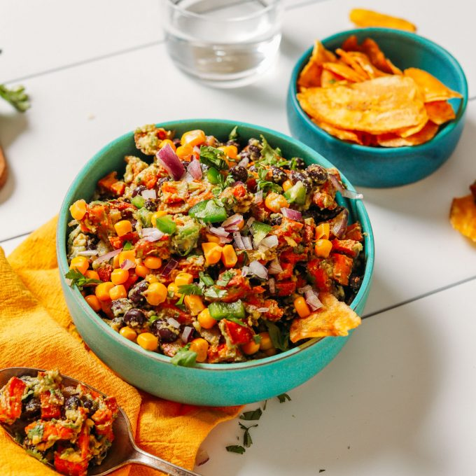 Bowl of Southwest Sweet Potato Black Bean Dip beside a bowl of plantain chips