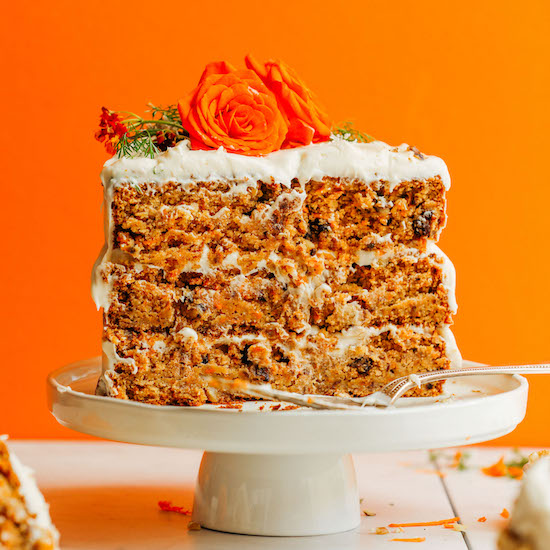 Partially eaten three-tier gluten-free carrot cake