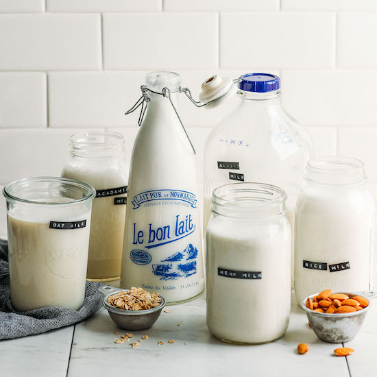 Homemade dairy-free milk in jars and glass bottles