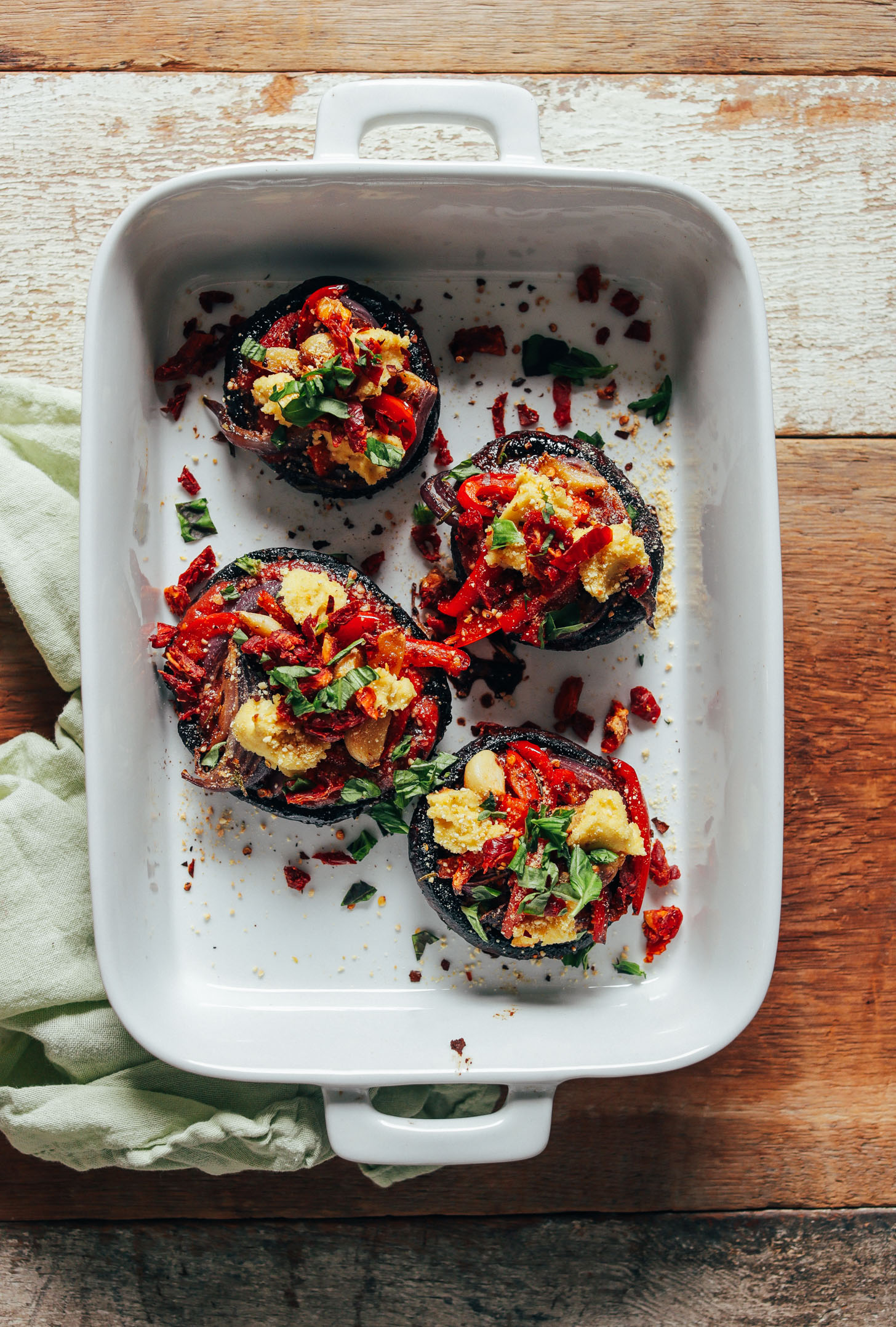 White baking dish filled with Balsamic-Marinated Portobello Pizzas for a delicious vegan meal