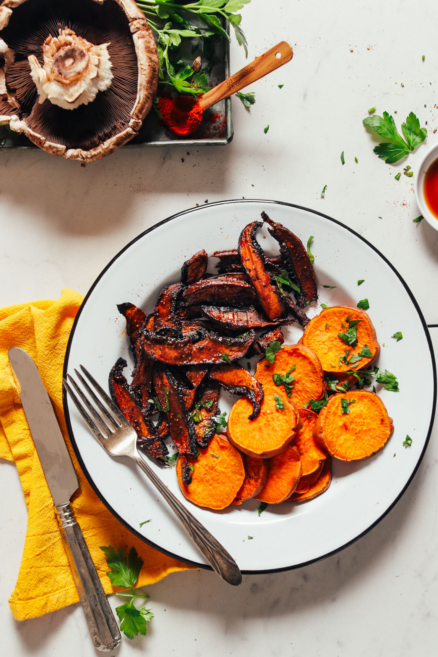 Plate of freshly baked sweet potatoes and Portobello Bacon topped with fresh parsley