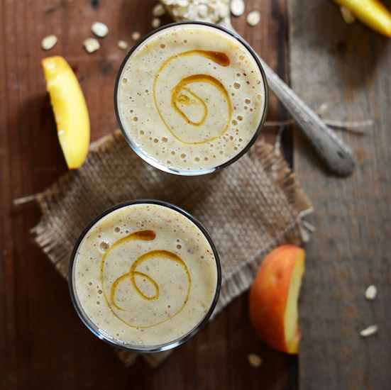 Top down shot of two glasses of our Peach Oat Smoothie recipe