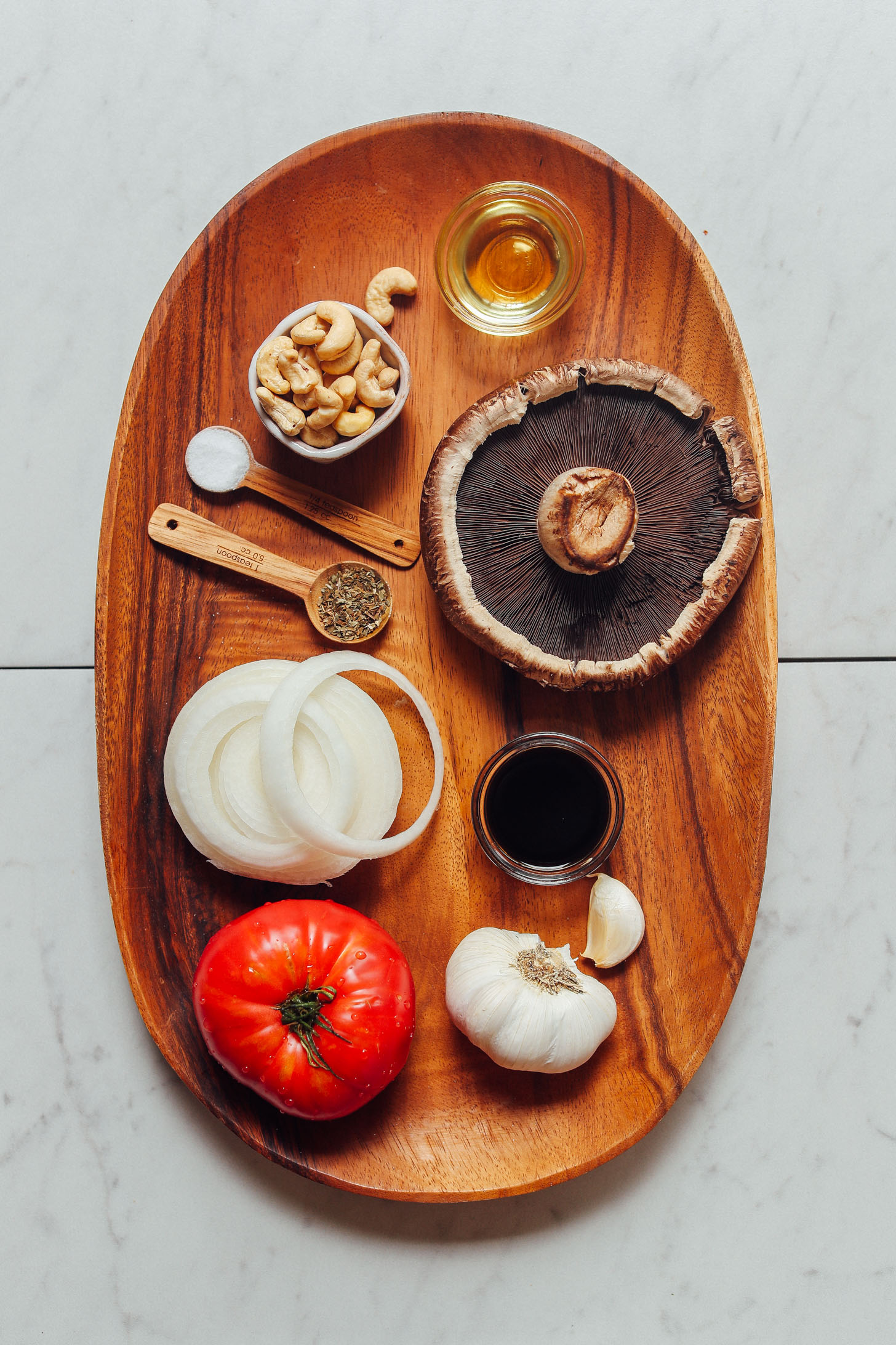 Wood tray filled with ingredients for making homemade Balsamic Marinated Portobello Burgers with Caramelized Onions