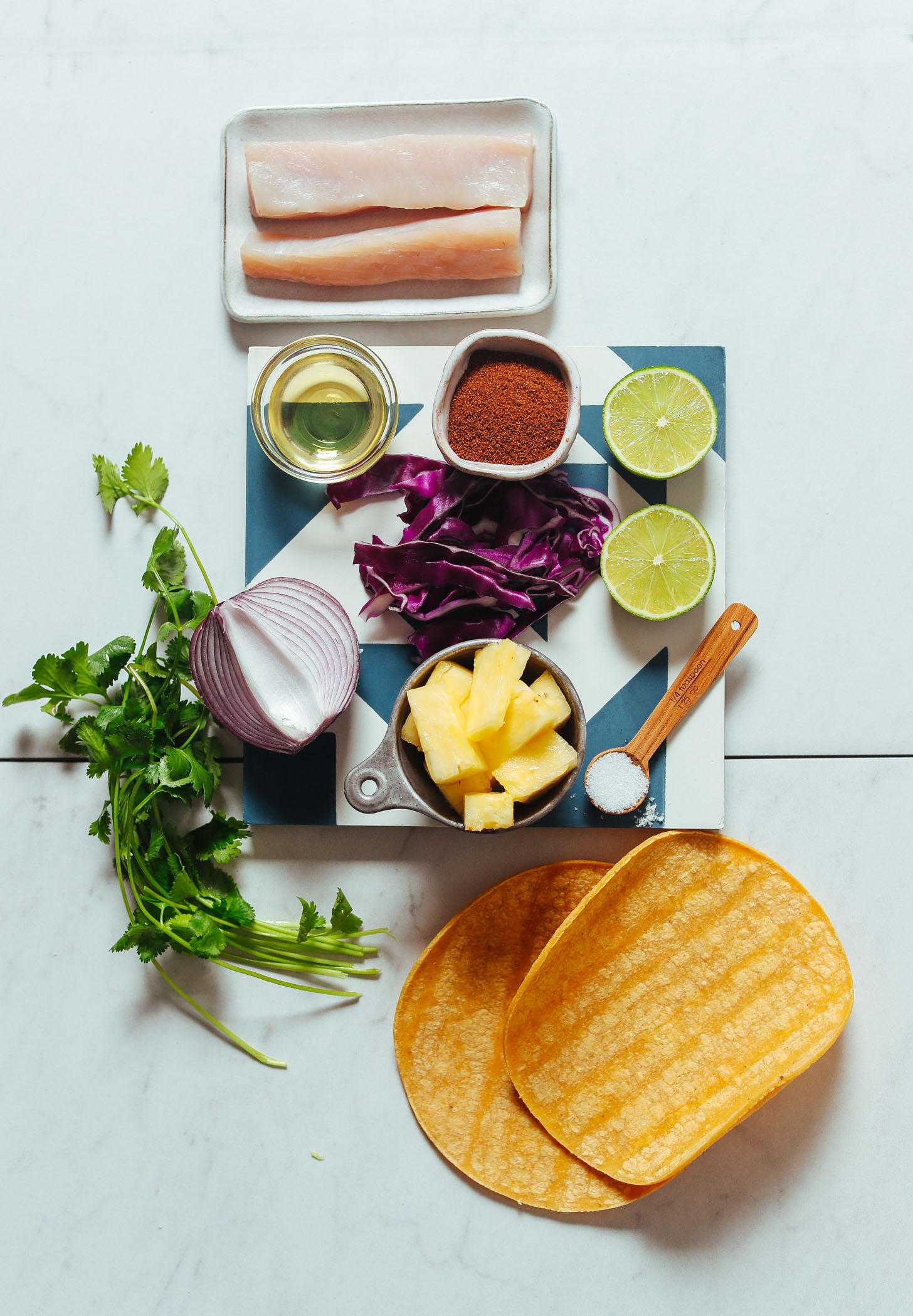 Assortment of ingredients for making Grilled Fish Tacos with Pineapple Cabbage Slaw