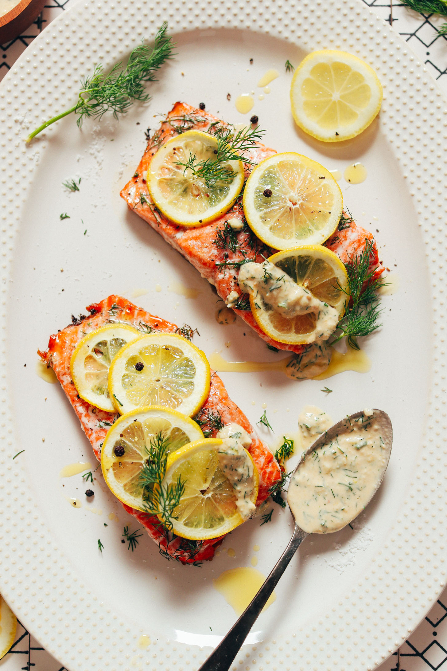 Platter with Dill & Lemon Salmon beside a spoonful of Quick Garlic Sauce