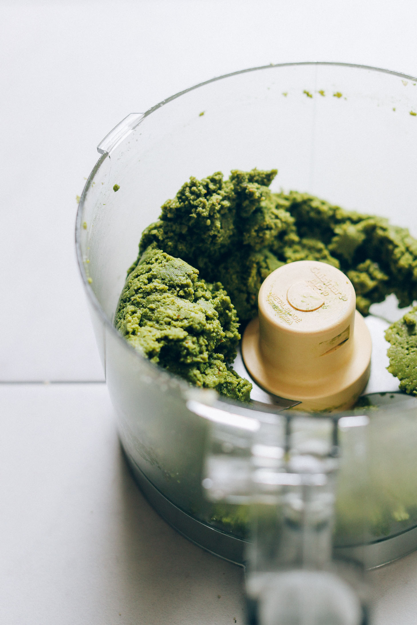 Food processor with dough for making plant-based Matcha Bliss Balls