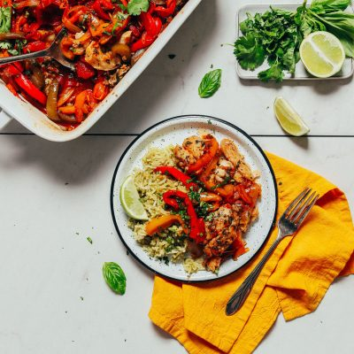 Plate and baking pan of our Baked White Fish recipe made with fresh herbs and Rainbow Bell Peppers
