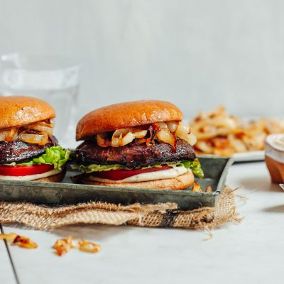 Tray of Balsamic Marinated Portobello Burgers topped with Caramelized Onions and Garlic Aioli