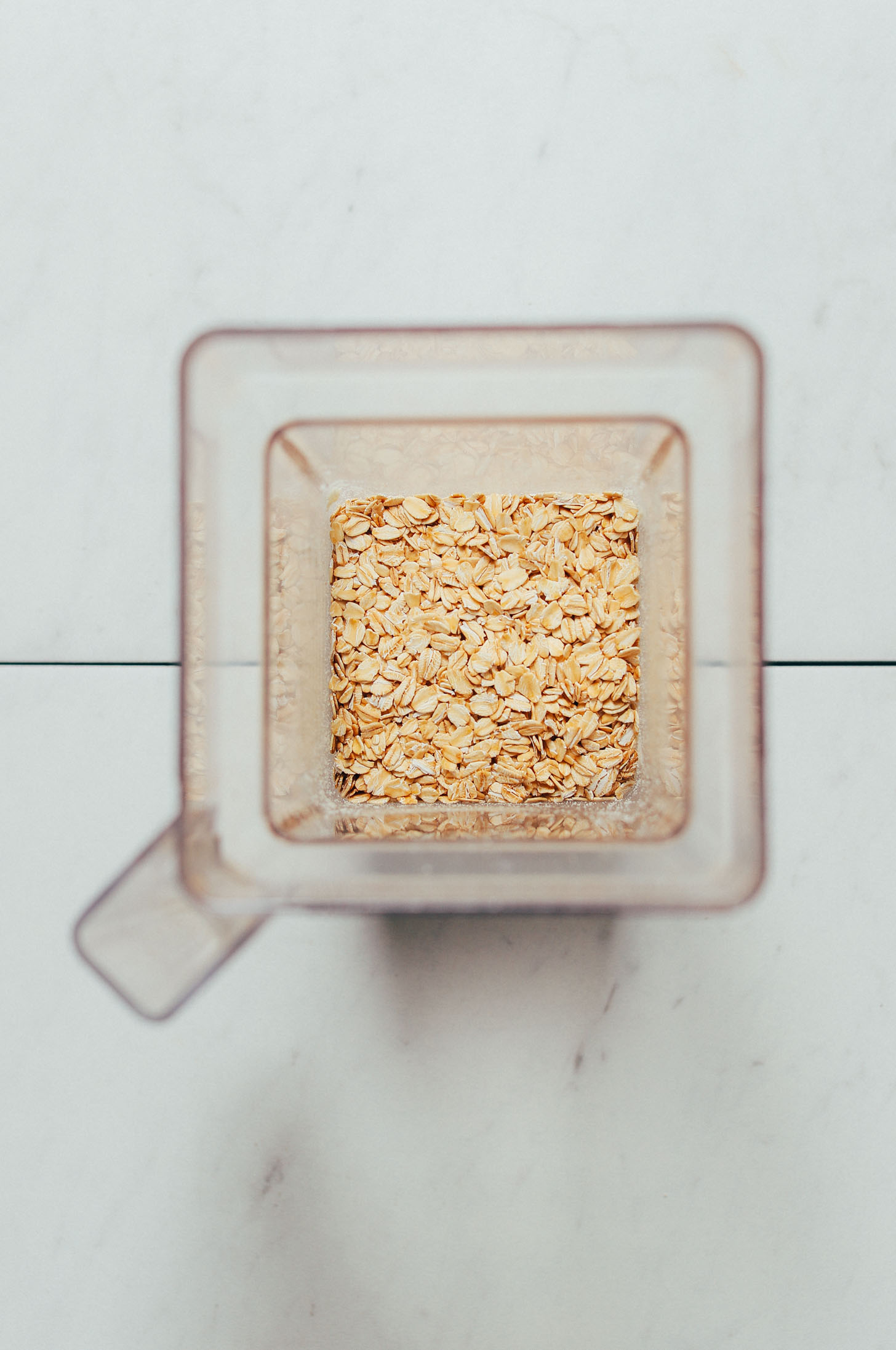 Blender of rolled oats for making homemade oat flour