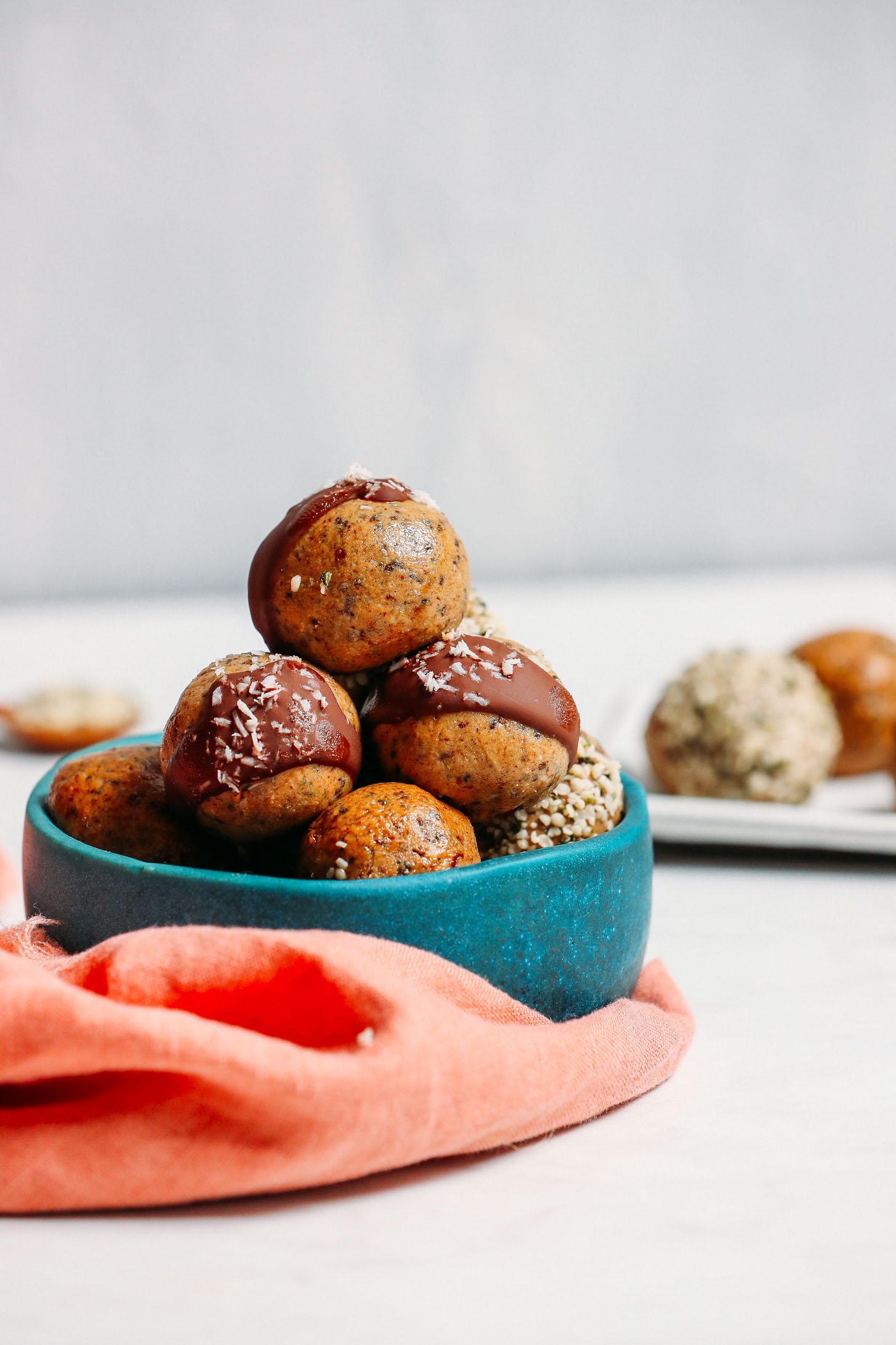 Bowl piled high with our grain-free, low sugar Protein Balls made with 5 simple ingredients