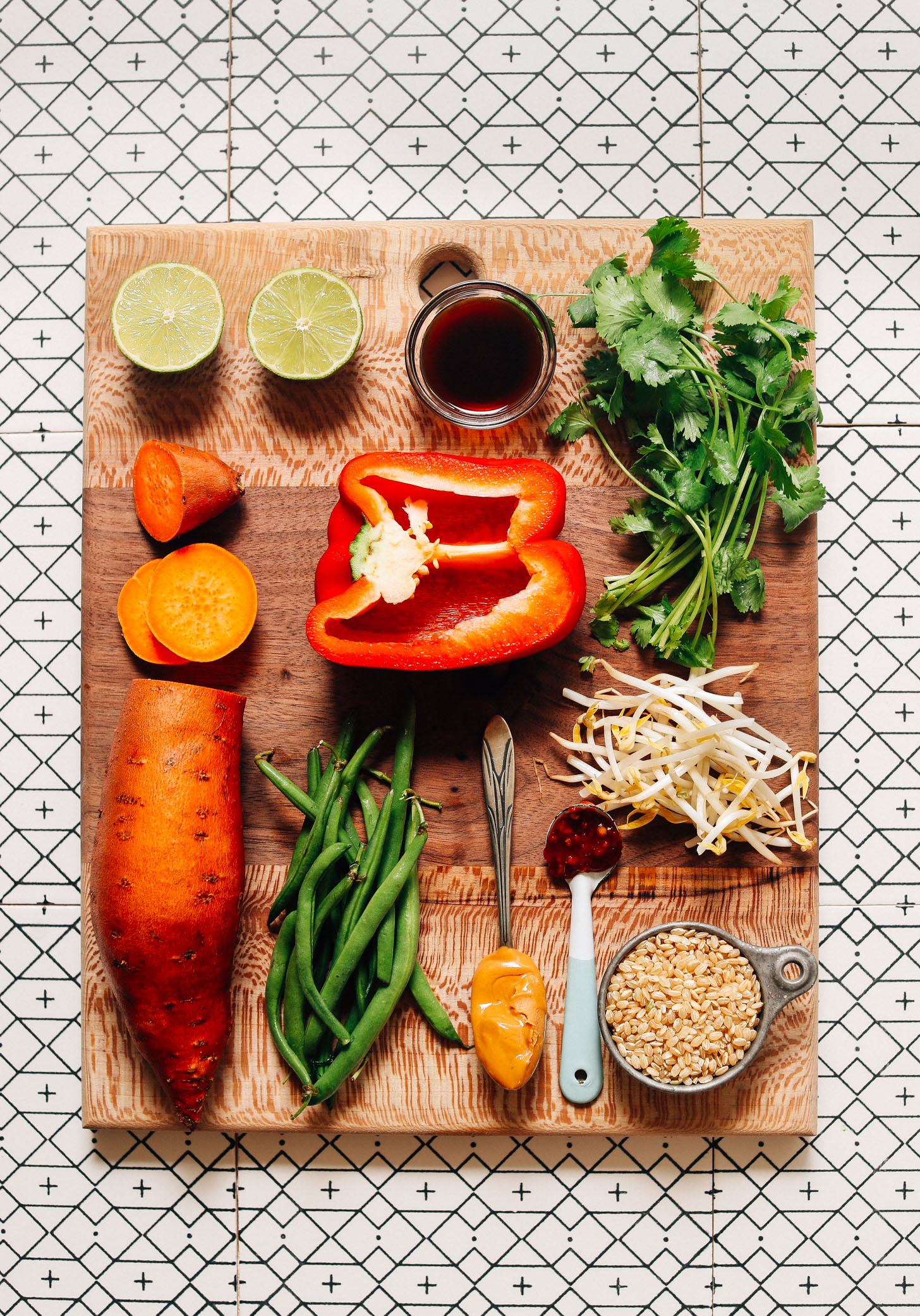 Wood cutting board filled with ingredients for making our Gado Gado with Spicy Peanut Sauce recipe