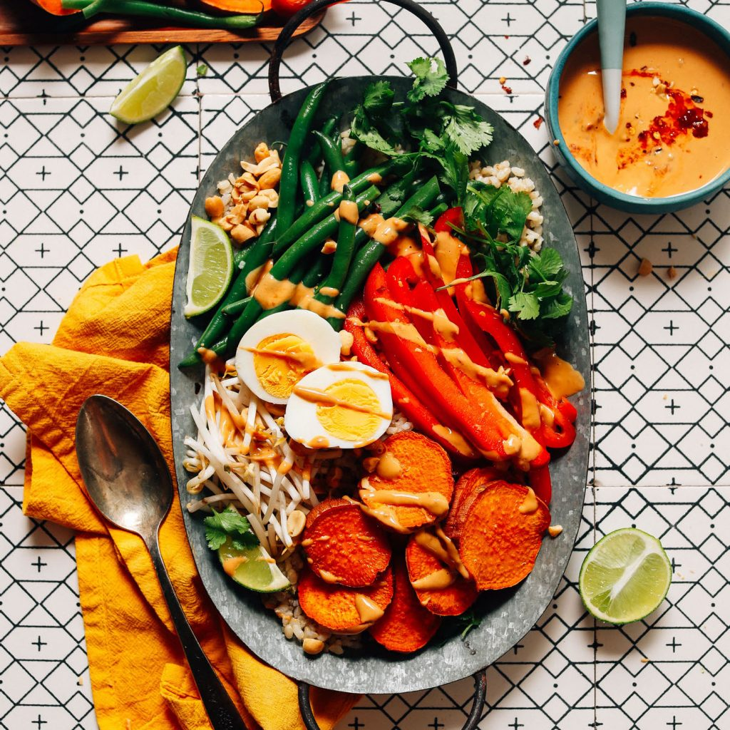 Tray filled with Gado Gado made with roasted and fresh vegetables and Spicy Peanut Sauce