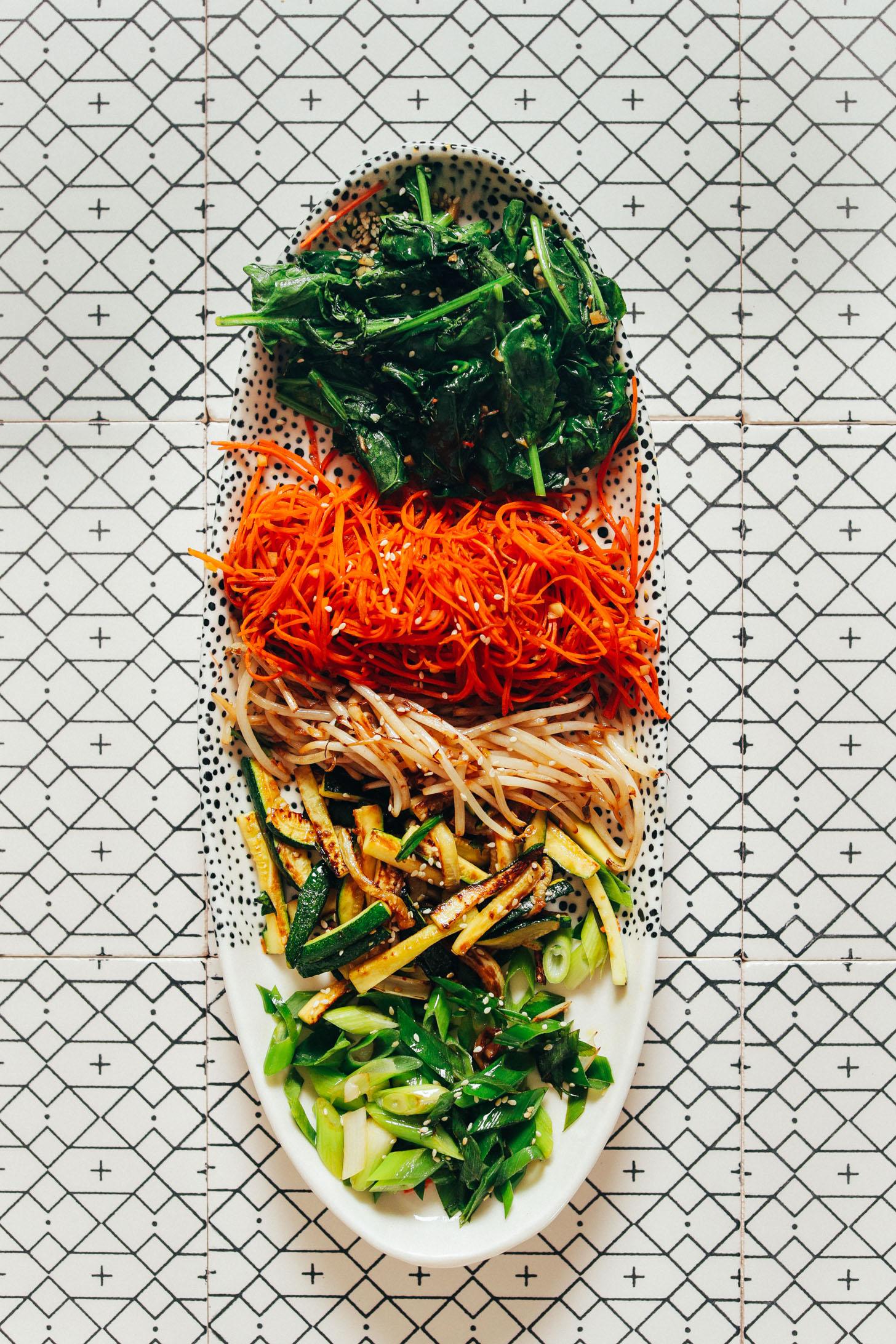 Platter of perfectly cooked vegetables for making Korean Bibimbap