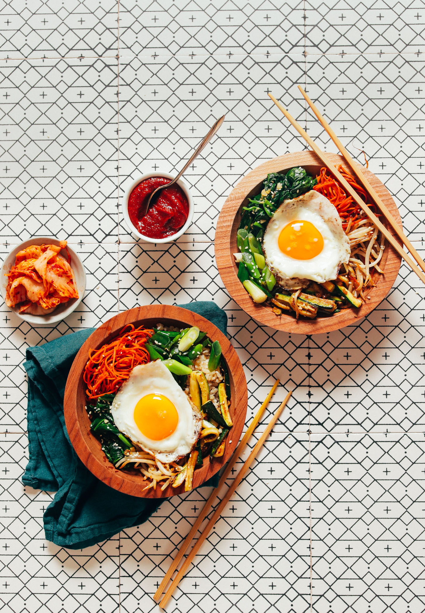 Bowls of homemade Korean Bibimbap with kimchi and Gochujang sauce