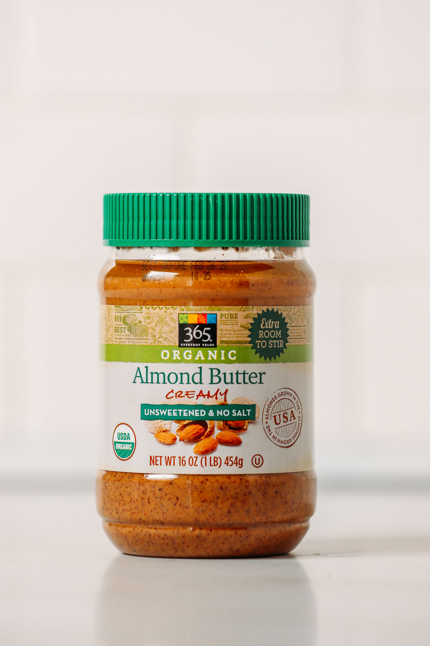 Jar of Whole Foods 365 Organic Almond Butter for our review of popular conventional and organic almond butter brands