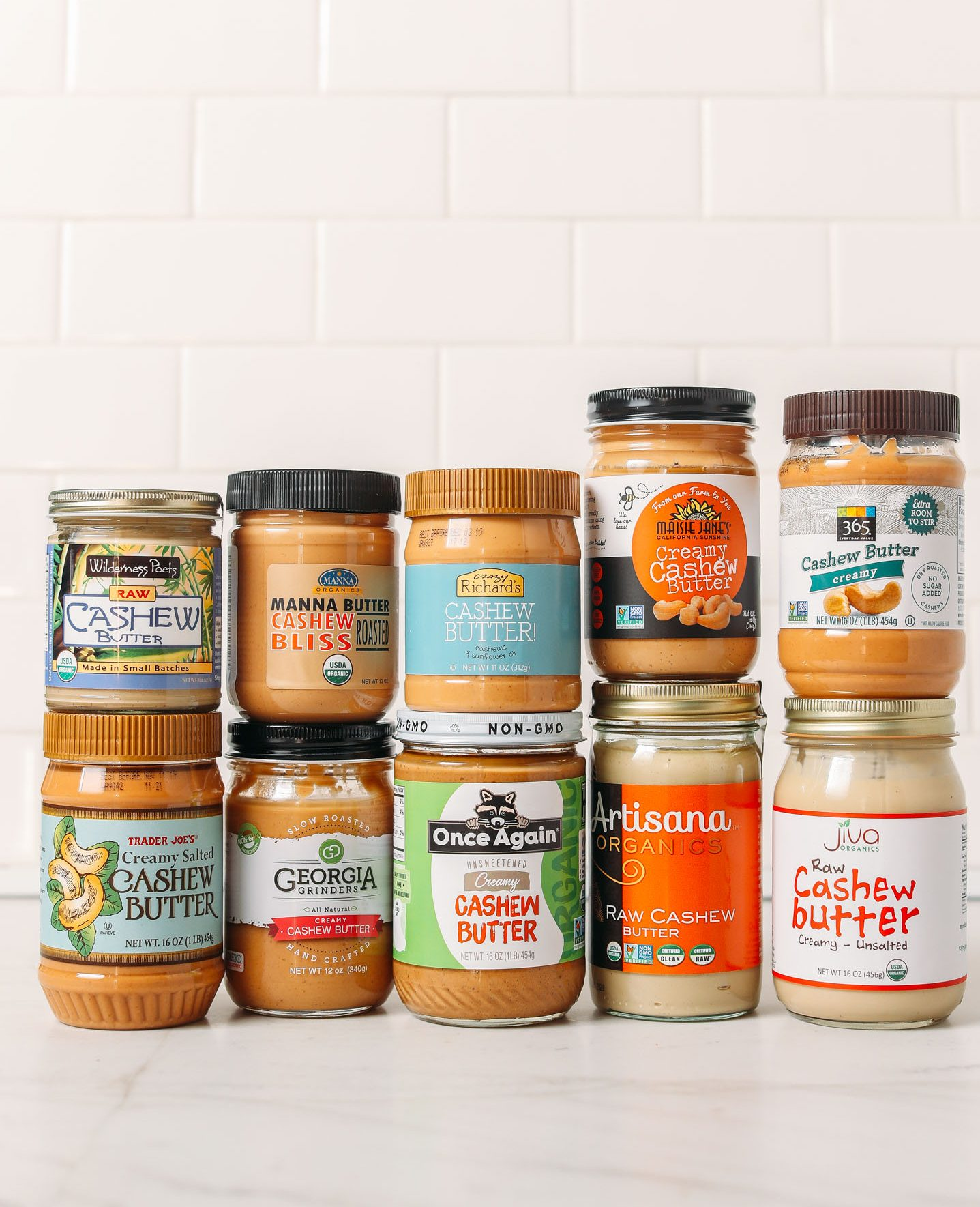 Jars of various brands of cashew butter for our unbiased review