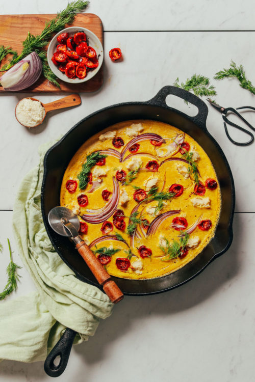 Mini pizza cutter resting in a pan of our Vegan Frittata recipe