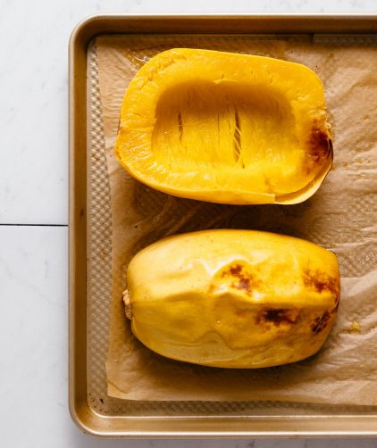 Perfectly roasted spaghetti squash on a baking sheet