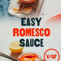 Top down and side shots of a jar of our Easy Romesco Sauce with text overlaid with the recipe title