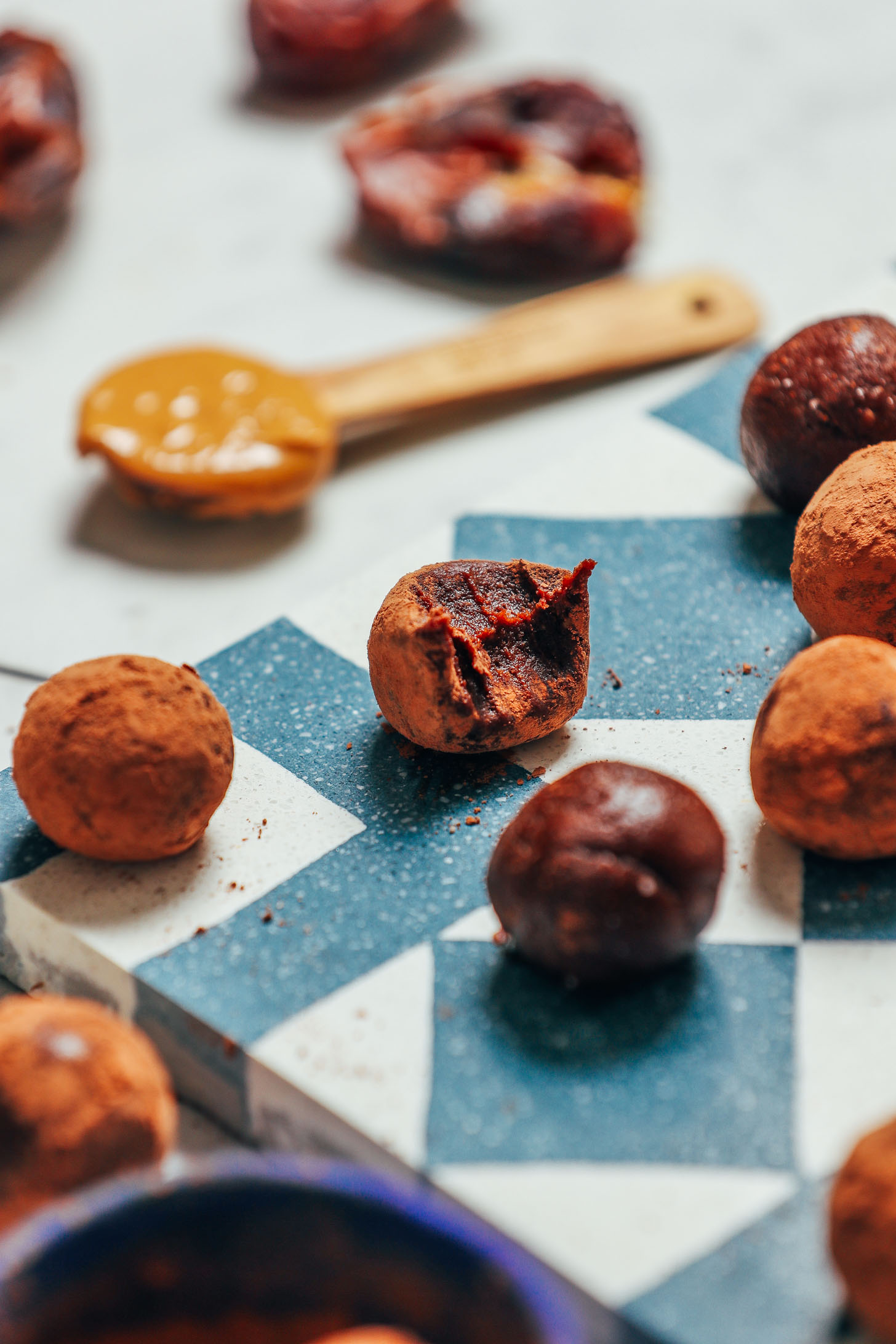 Date-sweetened Vegan Chocolate Truffles on a tile for a simple and delicious dessert