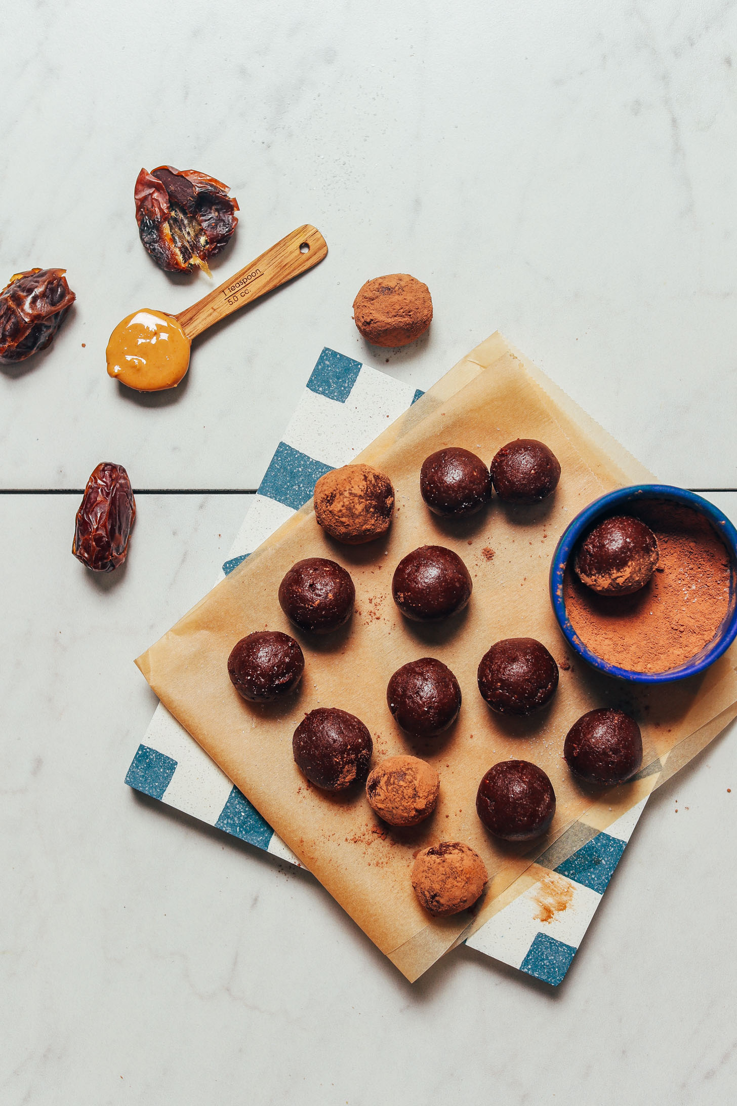 Dates, cashew butter, cacao powder, and a batch of freshly made Vegan Chocolate Truffles