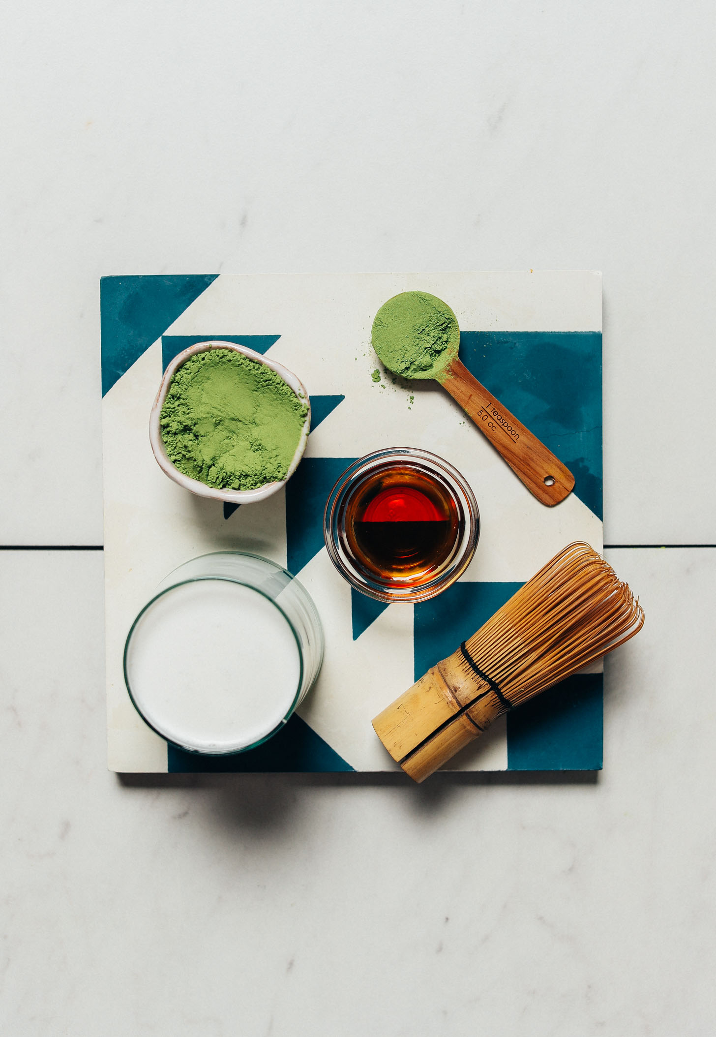 Tile with ingredients for making our creamy plant-based Moringa Latte recipe