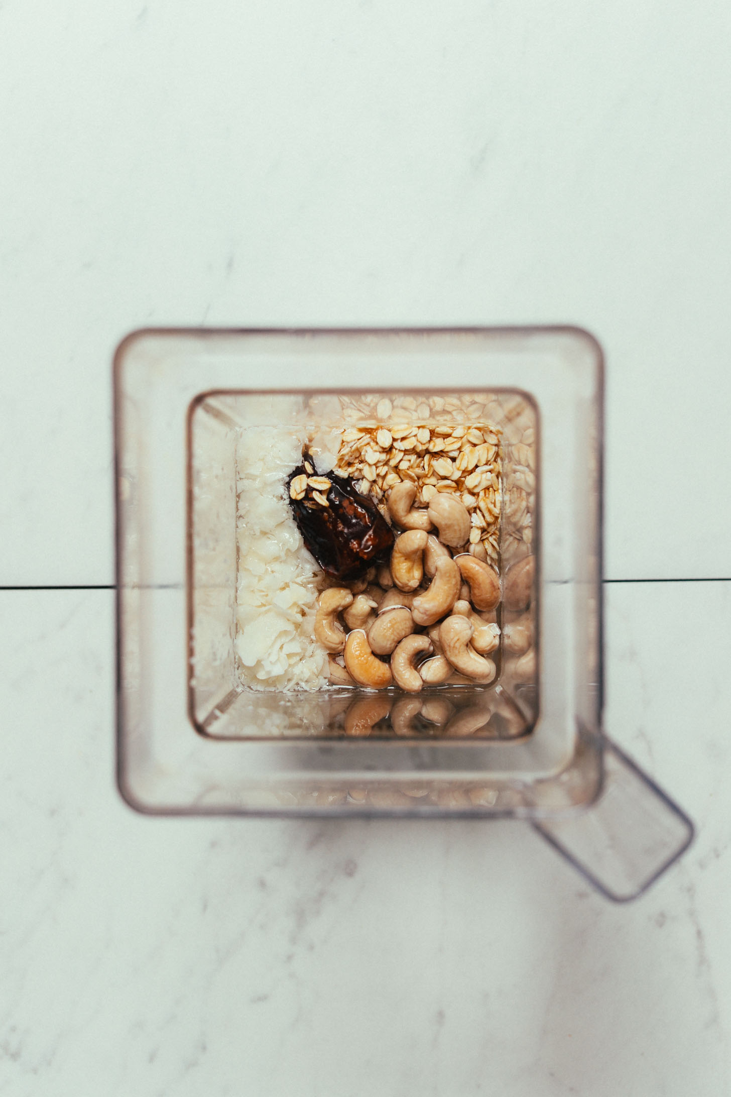 Blender filled with ingredients for making our Cashew Coconut Oat Milk Creamer