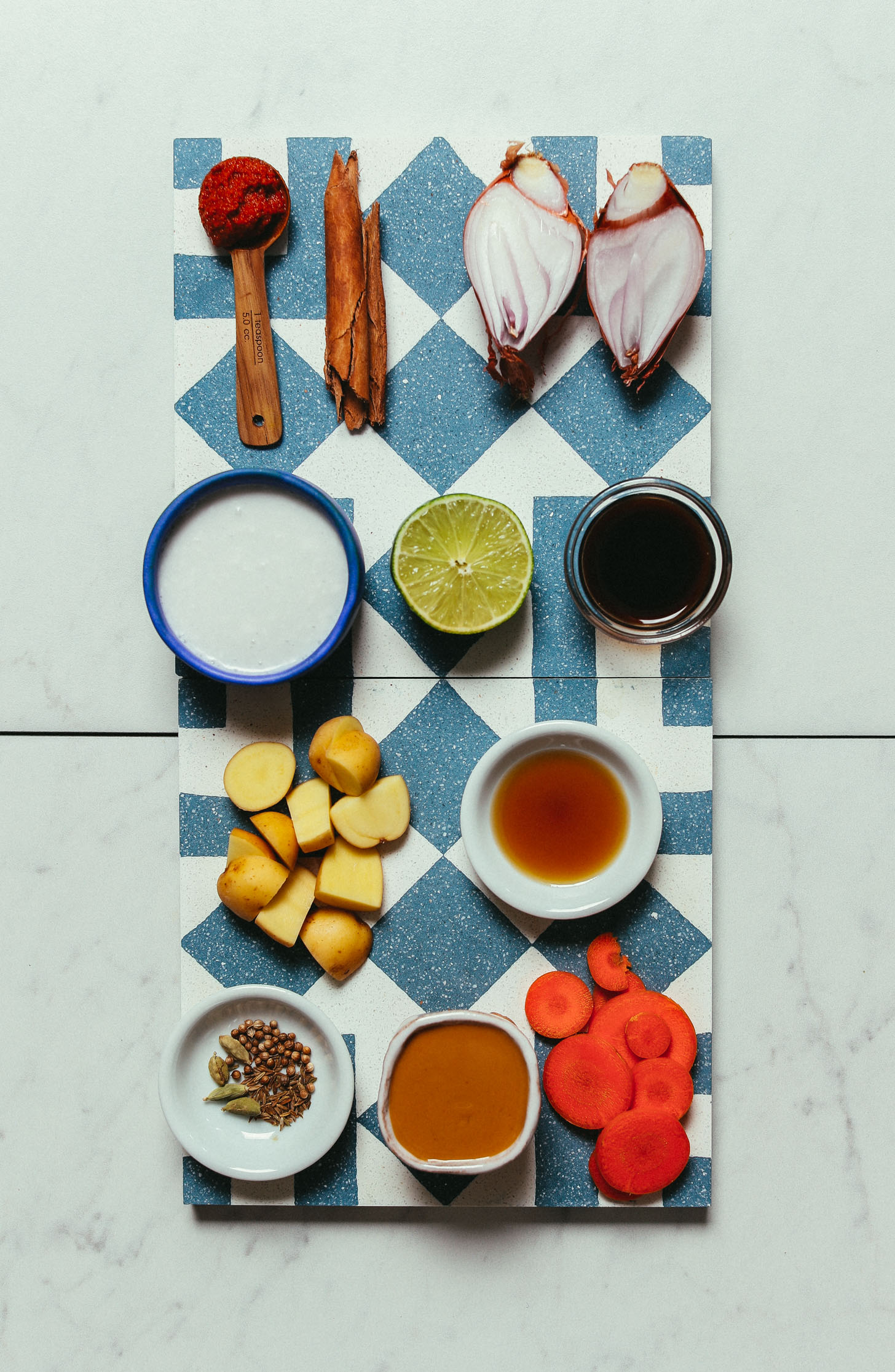 Tiles with ingredients for making our homemade vegan Massaman Curry recipe