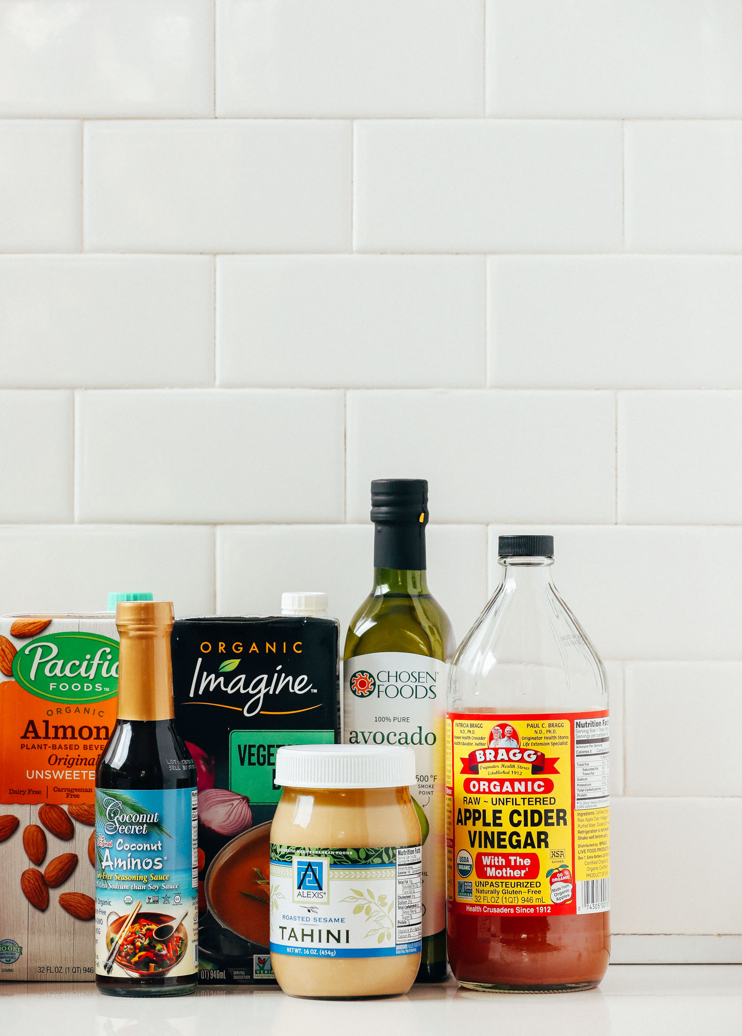 Tahini, coconut aminos, and other condiments included in our guide on How to Stock Your Pantry