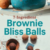 Tile and bowl filled with our simple Brownie Bliss Balls made with almond pulp