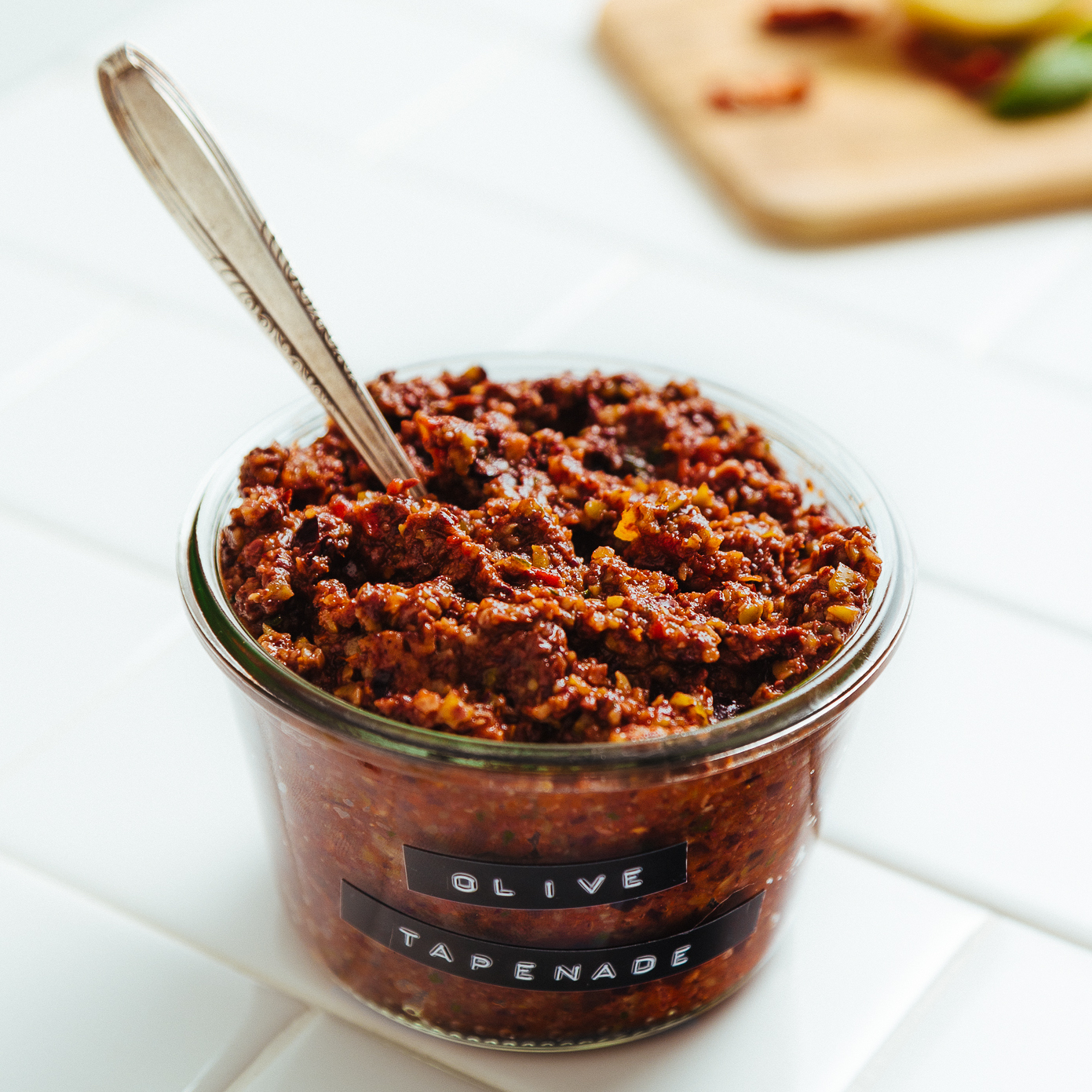 Jar of Sun-Dried Tomato and Basil Olive Tapenade for spreading on crackers or vegetables