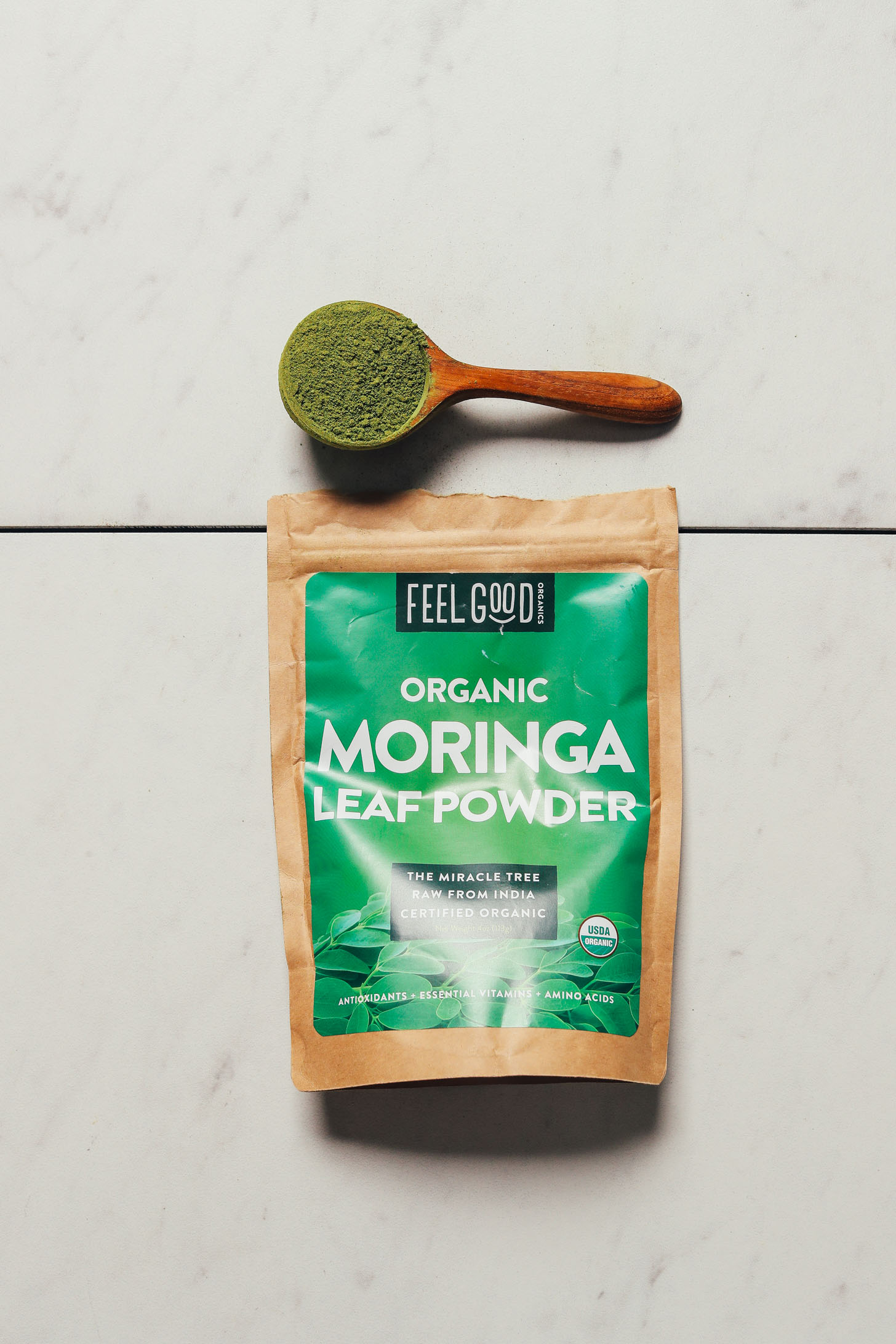 Bag and spoonful of Feel Good Moringa Powder for our review of the best moringa brands