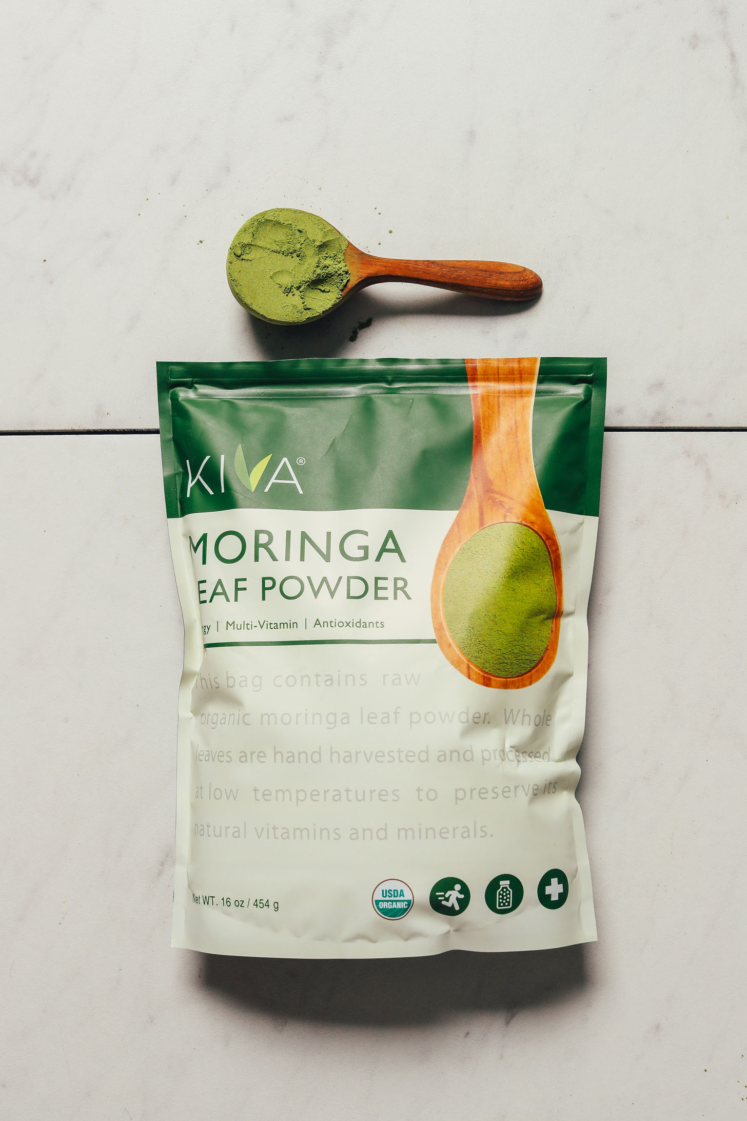 Package and spoonful of Kiva Moringa powder for our review of the best moringa powder brands